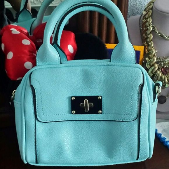 Babyblue small cross body purse This purse is brand new and never used ! It is very roomy ! Has the crossbody strap so you can change it when ever you want to use it as a crossbody or a purse. Any questions feel free to ask or make offers Merona Bags Crossbody Bags