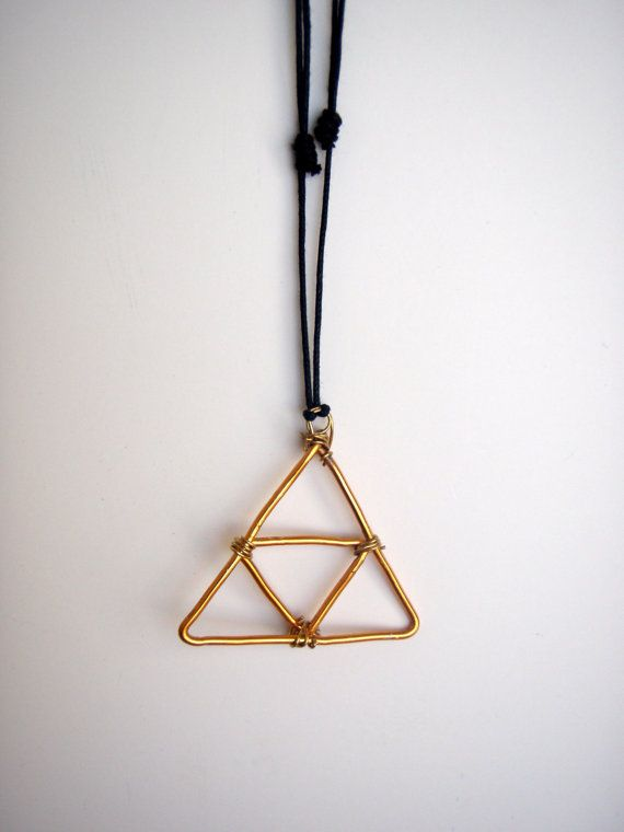 This necklace features a wire wrapped Triforce from The Legend of ...