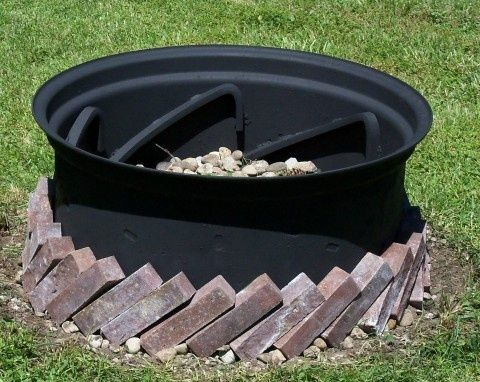 Our homemade fire pit. An old, re-painted tractor tire rim ...