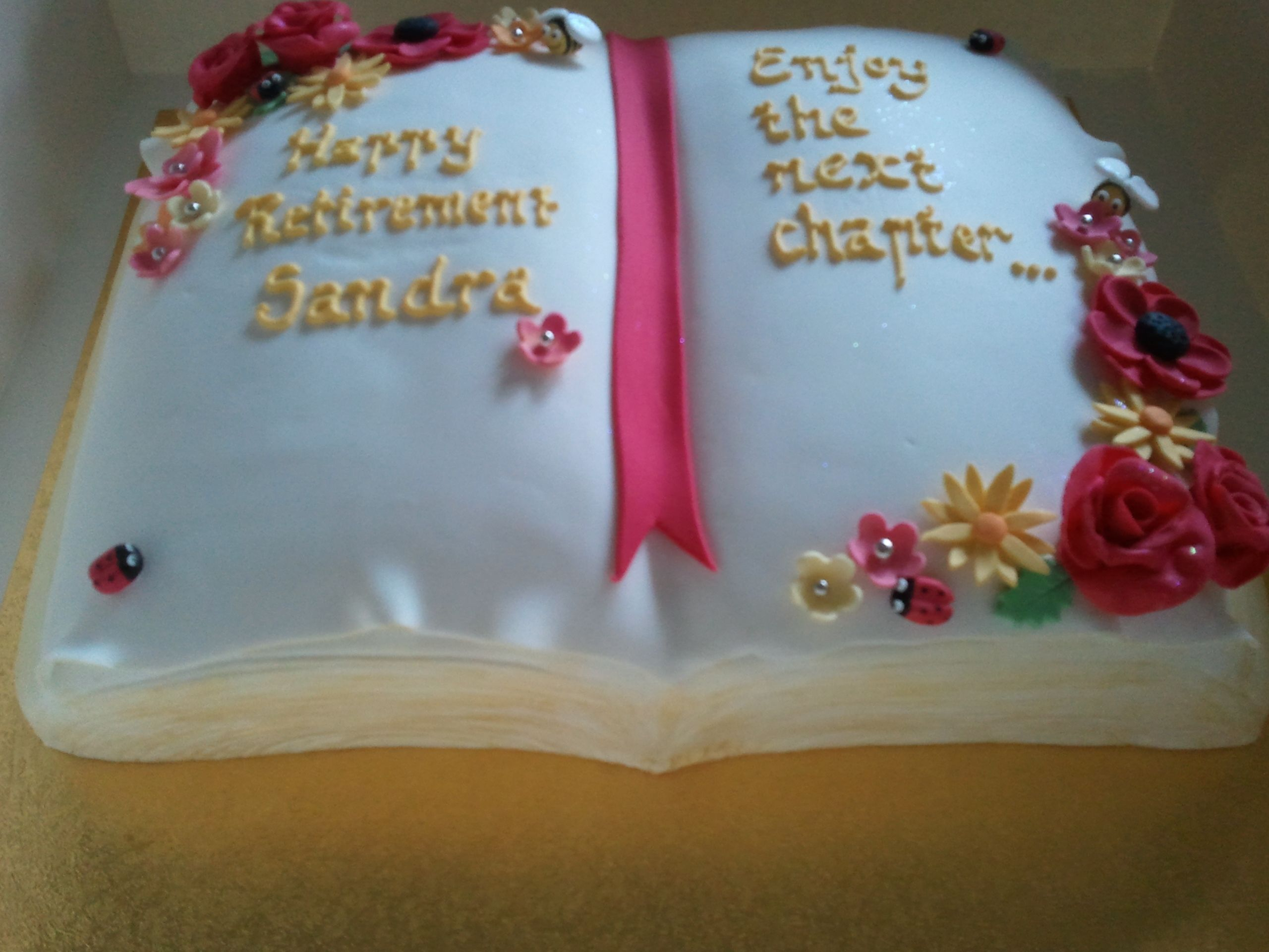 Happy Retirement Sandra - Chocolate cake, carved and covered with fondant and handmade fondant decorations. Made with love for a work colleague and friend.
