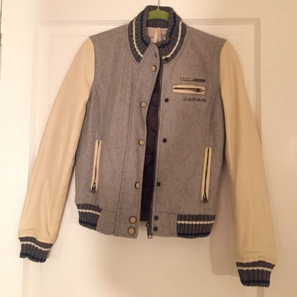 SALE! Superdry leather sleeve varsity jacket XS Awesome varsity jacket, lined inside. No pilling on the wool, no cracks or wearing on the sleeves. Japanese embroidery on the back of the neck, ribbed cotton under the arms for comfort. There is one imperfect, slight ball pen marks less than a 1/4 in on the sleeve. Ask for pics if interested. Make an offer! Superdry Jackets & Coats Utility Jackets