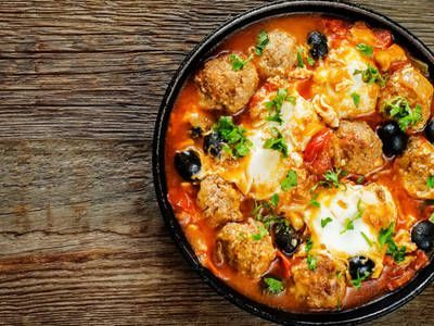 Photo of Homemade meatballs simmered in marinara and topped with mozz…