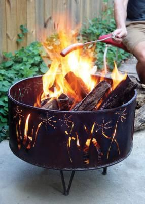 Rustic metal fire pit. this guy is sort of funky and cool
