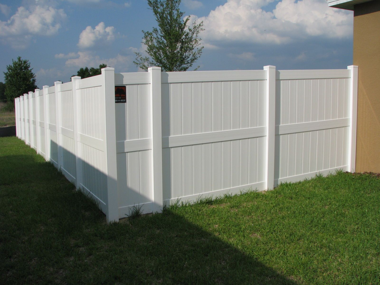 Custom white pvc midrail fence design mossy oak fence company for the last fifteen years florida has been the fasted growing vinyl fence market in the countr baanklon Gallery