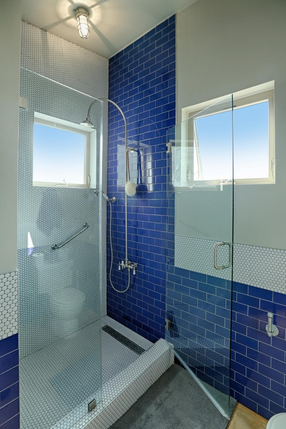 In this contemporary bath, royal blue subway tile pops against white ...