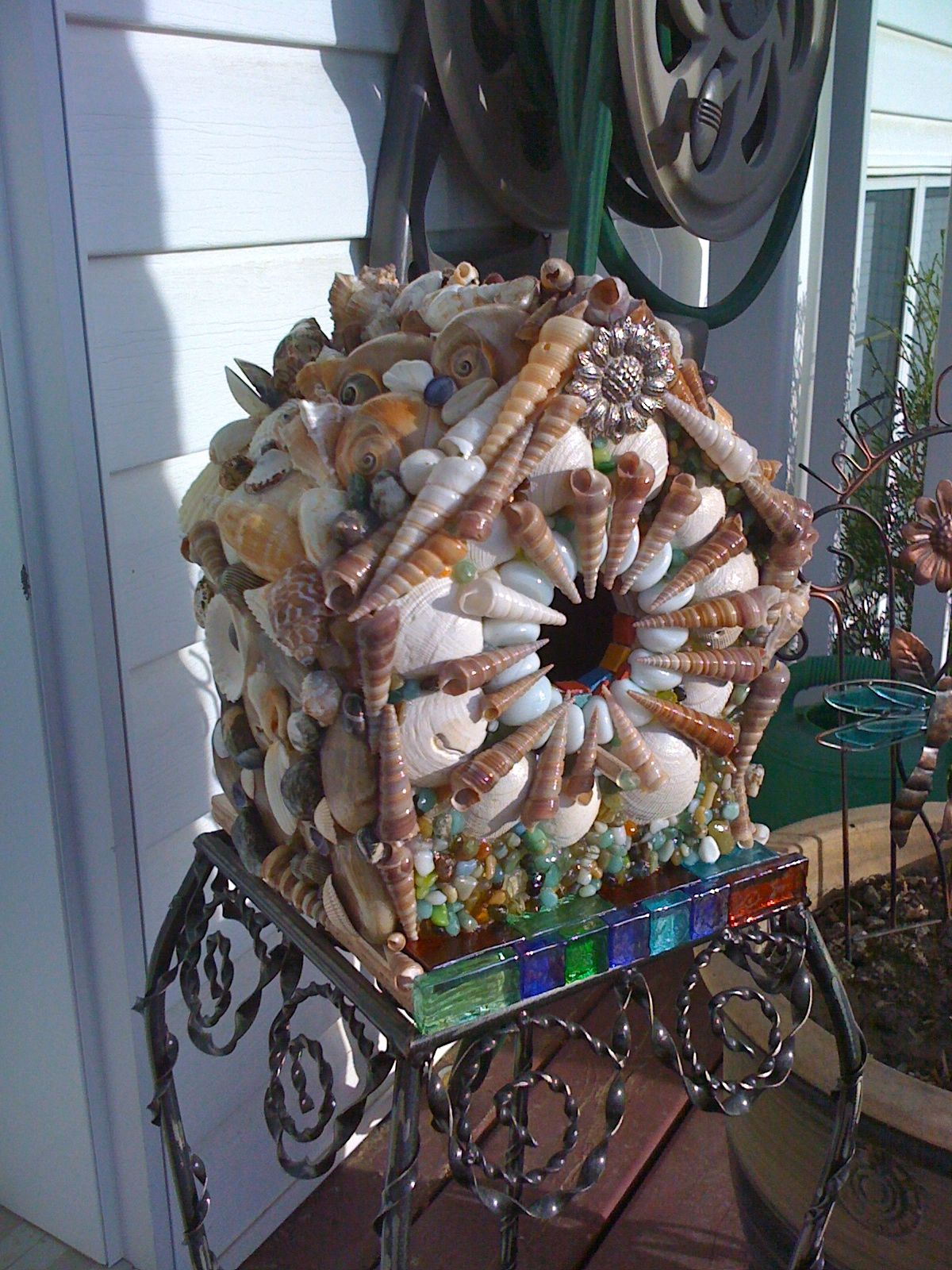 another bird house this one with sea shells and rocks sea