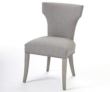 Sleek dining chair in slate textured fabric with heather grey finish on solid maple legs and steel nail trim detail along base and outside back. Available in choice of other fabrics or leathers and finishes.