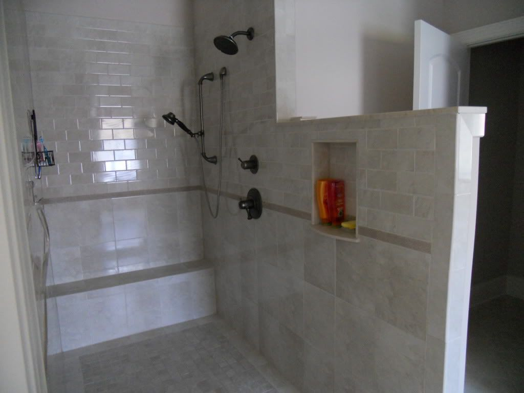 Classic tile half wall bench double shower heads for Master bathroom no door