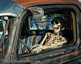 Image result for skeleton in a rusted car