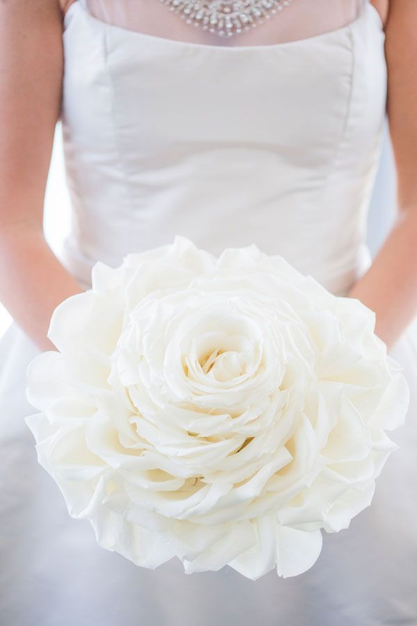 white rose composite bouquet. This could be nice in red