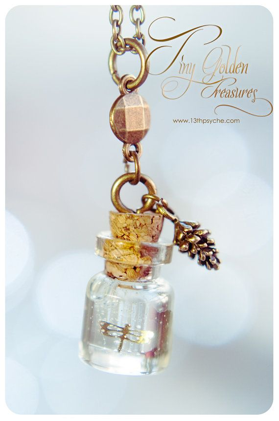 A beautiful handmade tiny glass bottle necklace with Tiny Golden ...