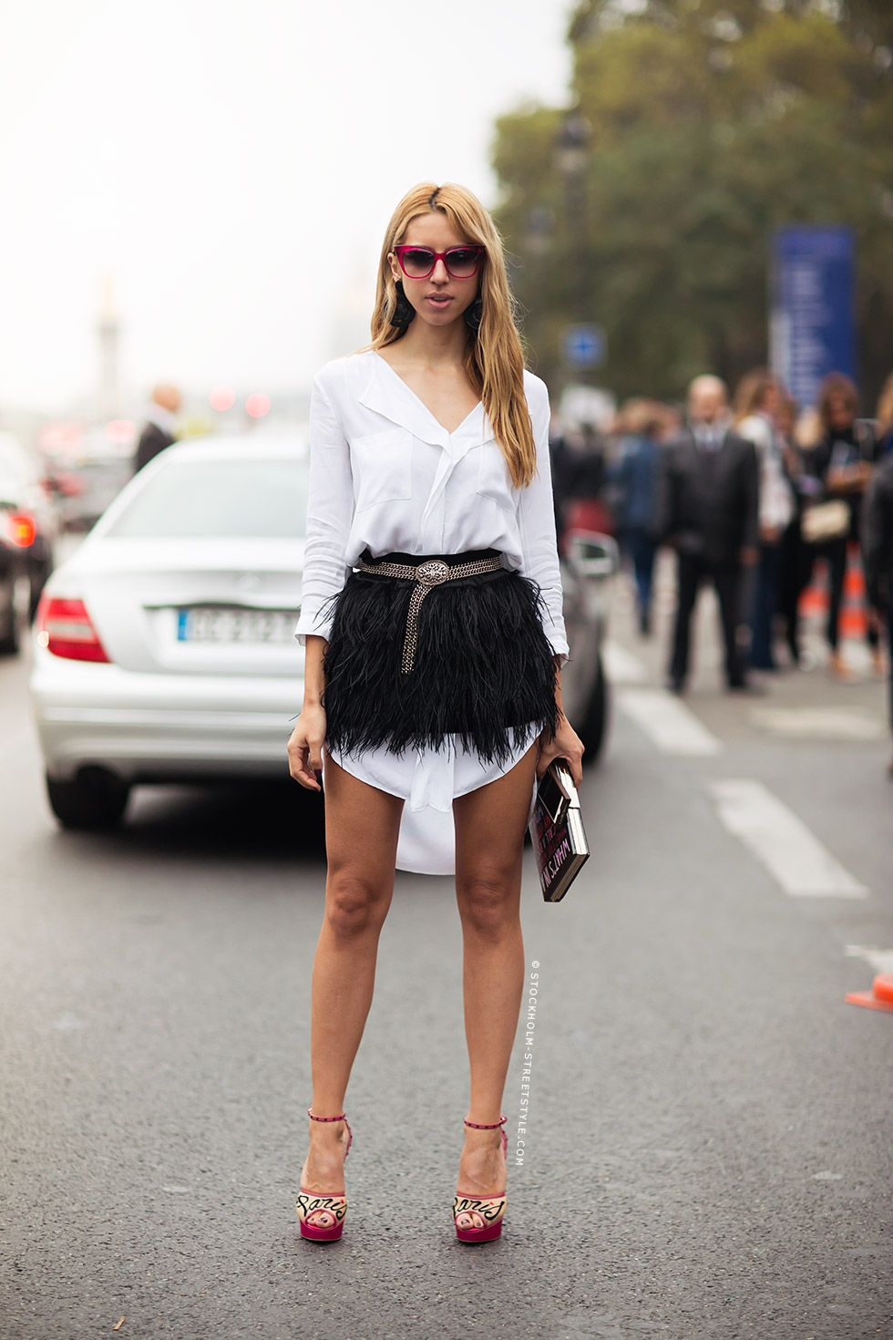 white shirt chic with feathers. why not. Paris.