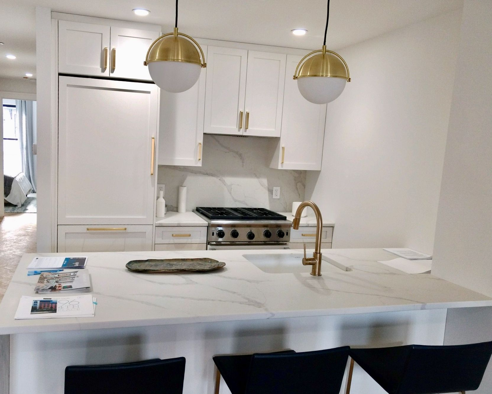 What S Trending Now In Kitchens Is Combining White Cabinetry With Gold Hardware The Results Gorgeous Small White Kitchens White Kitchen Design Kitchen Design