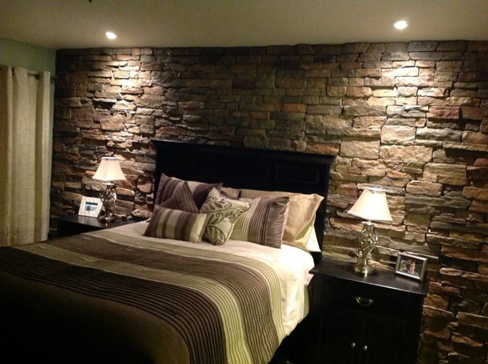 Rock accent wall in the master bedroom home decor - Wall decoration ideas for bedrooms ...