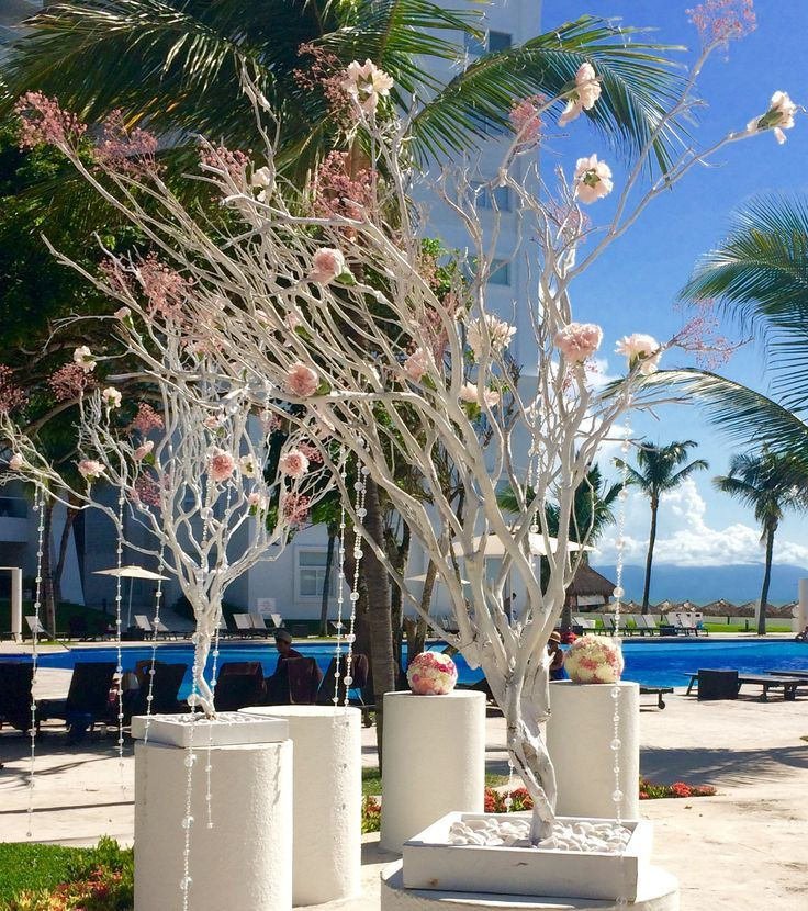 Trees and flowers makes for elegant decor for your garden ceremony at Dreams Villamagna!