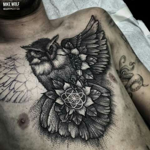 Chest tattoo by Mike Wolf