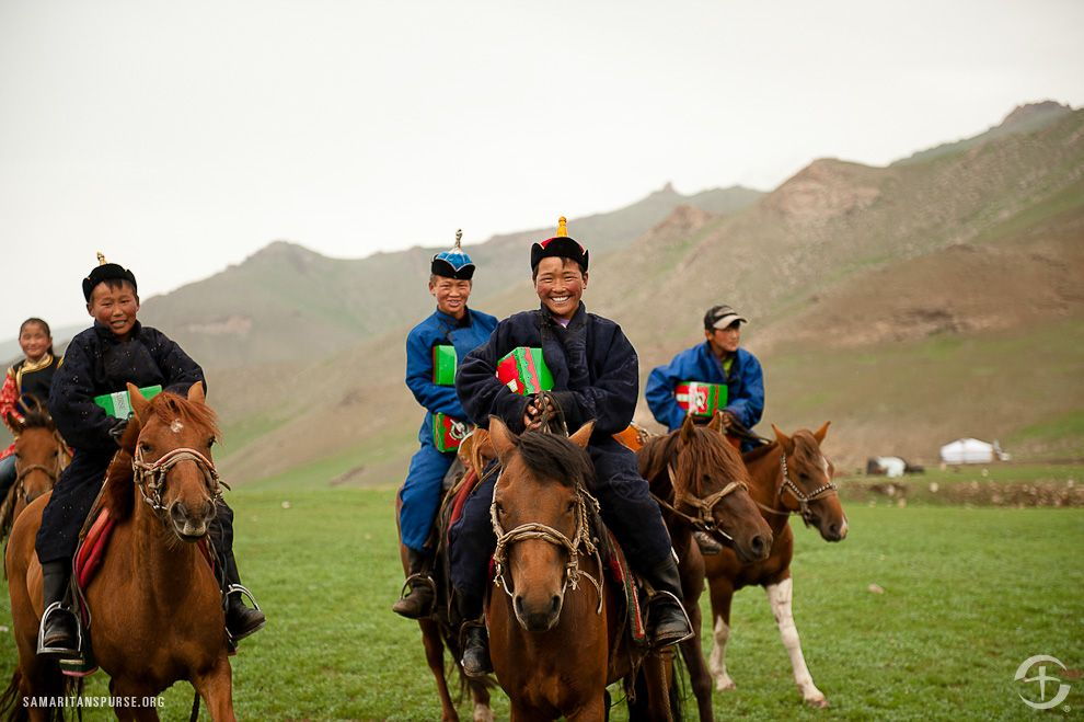 Mongolian Youth With Their Operation Christmas Child Gifts Close