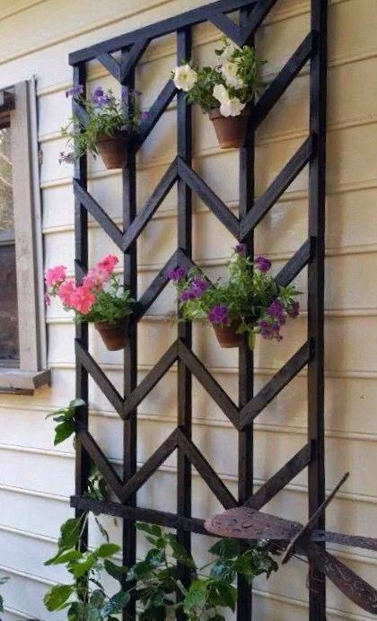 Add Color And Life To A Dull Wall With Clay Flower Pots Hanging On A Trellis Secure The Pots With Hangapot Ha Diy Garden Trellis Diy Trellis Backyard Projects
