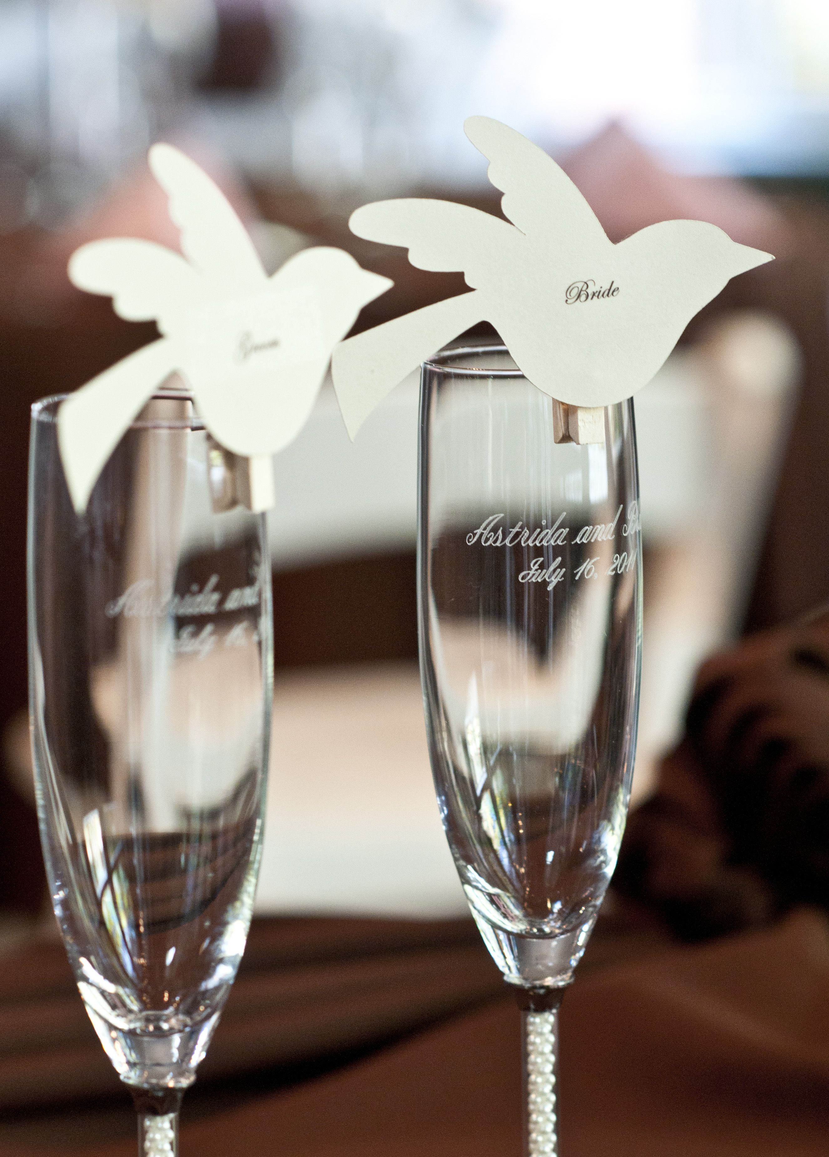 Easy and cute DIY place cards for a wedding. I used a Cricut machine to cut out birds then printed the guests names onto clear return address labels and attached them to the cut out. Then all you need to do is hot glue them to mini wooden clips. Simply clip them to the rim of the glass and you're good to go! Looks cute and they're easy to spot. **Photo by the fantastic Samantha Randall Photography. See more of her amazing work at http://www.samantharandall.com
