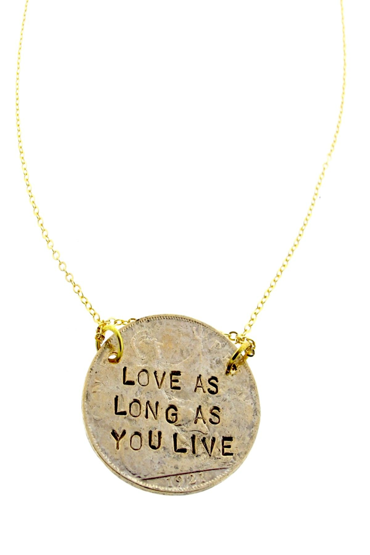 """flip side says """"laugh as much as you breathe""""  [pendant necklace]"""