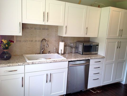 Cabinets With Ouro Romano Countertops