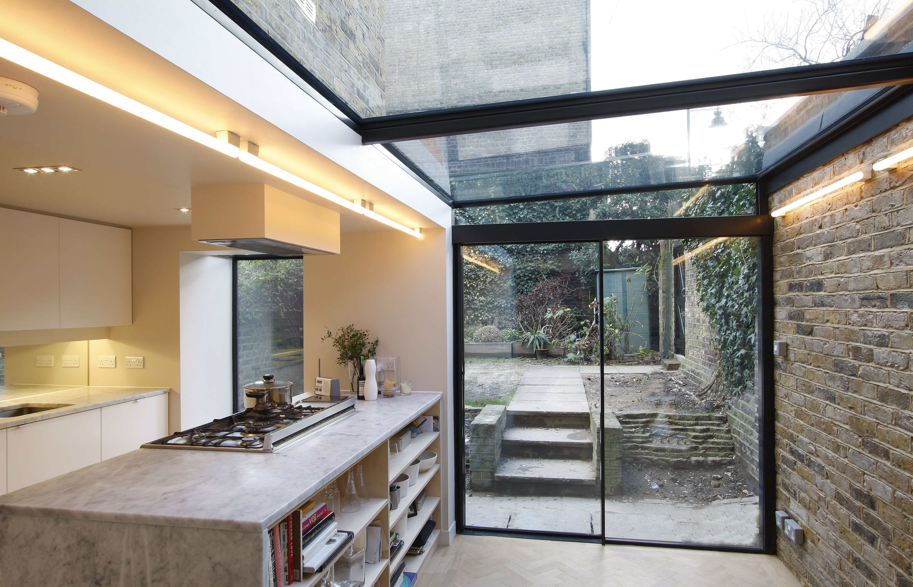 Minimal windows sliding doors to side infill extension for Building a kitchen extension ideas