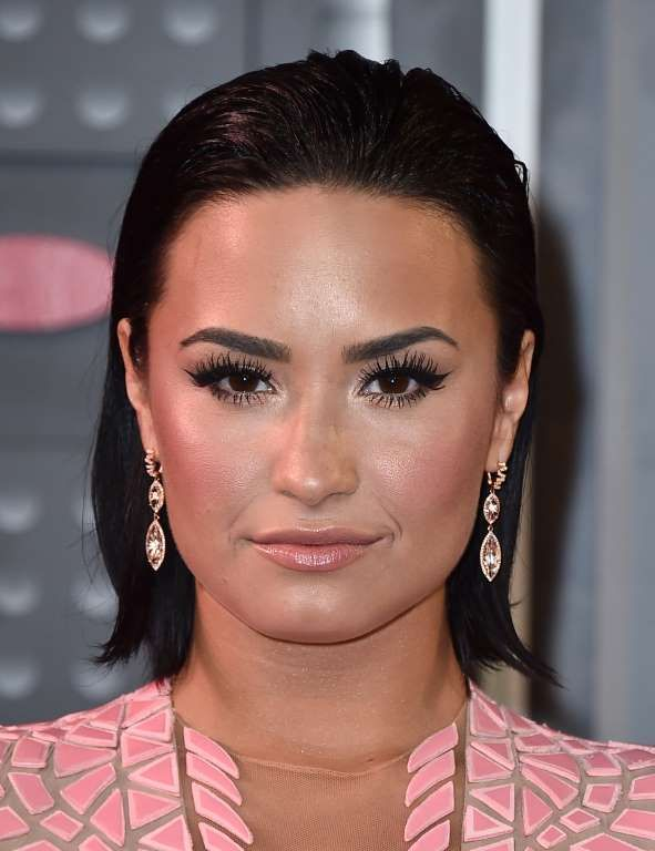 We like how Demi Lovato used blush tones on her face to go with the color of her dress. And we want ... - Jordan Strauss/Invision/AP