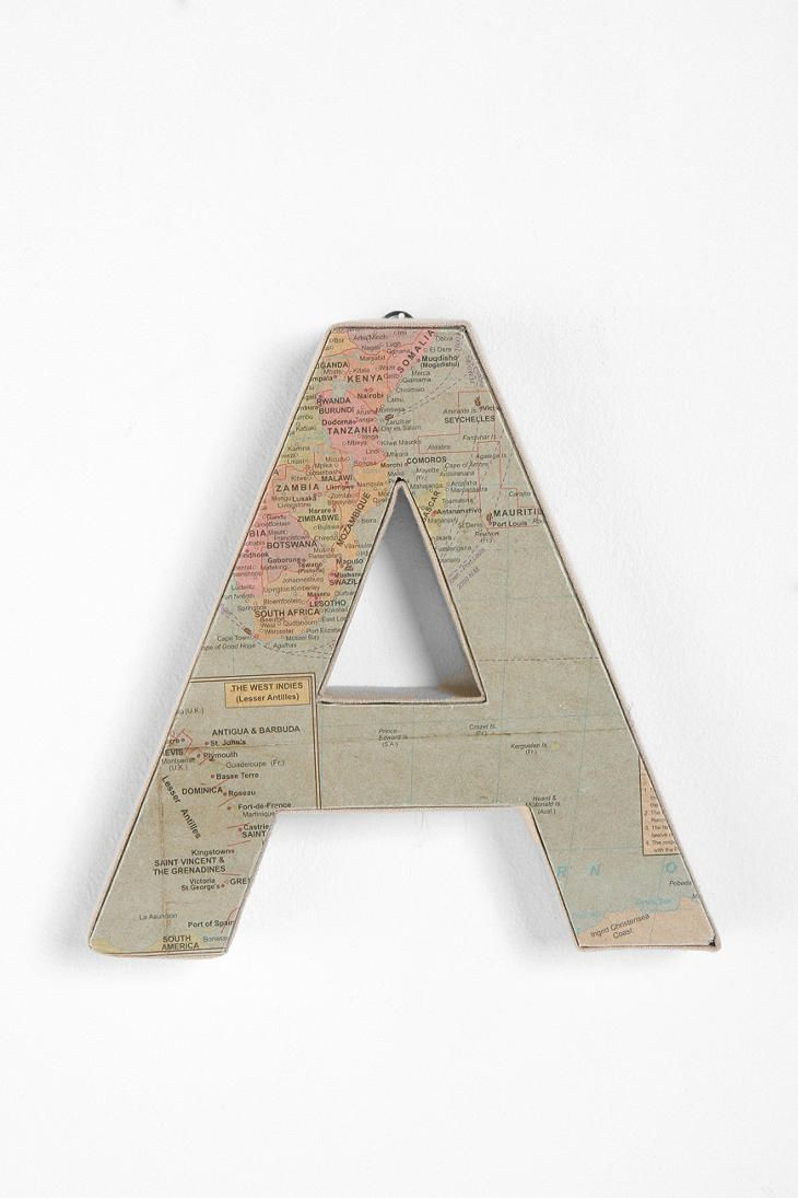 "I love letters and this map covered letter is extra fun. Looking for some way to decorate above my couch. Thinking it might be cool to paint a big square and put ""M""'s of all different sizes, shapes and materials in the square."