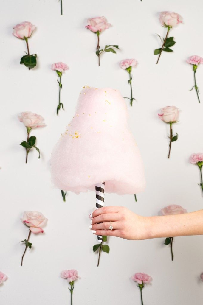 pink cotton candy with a flower backdrop.