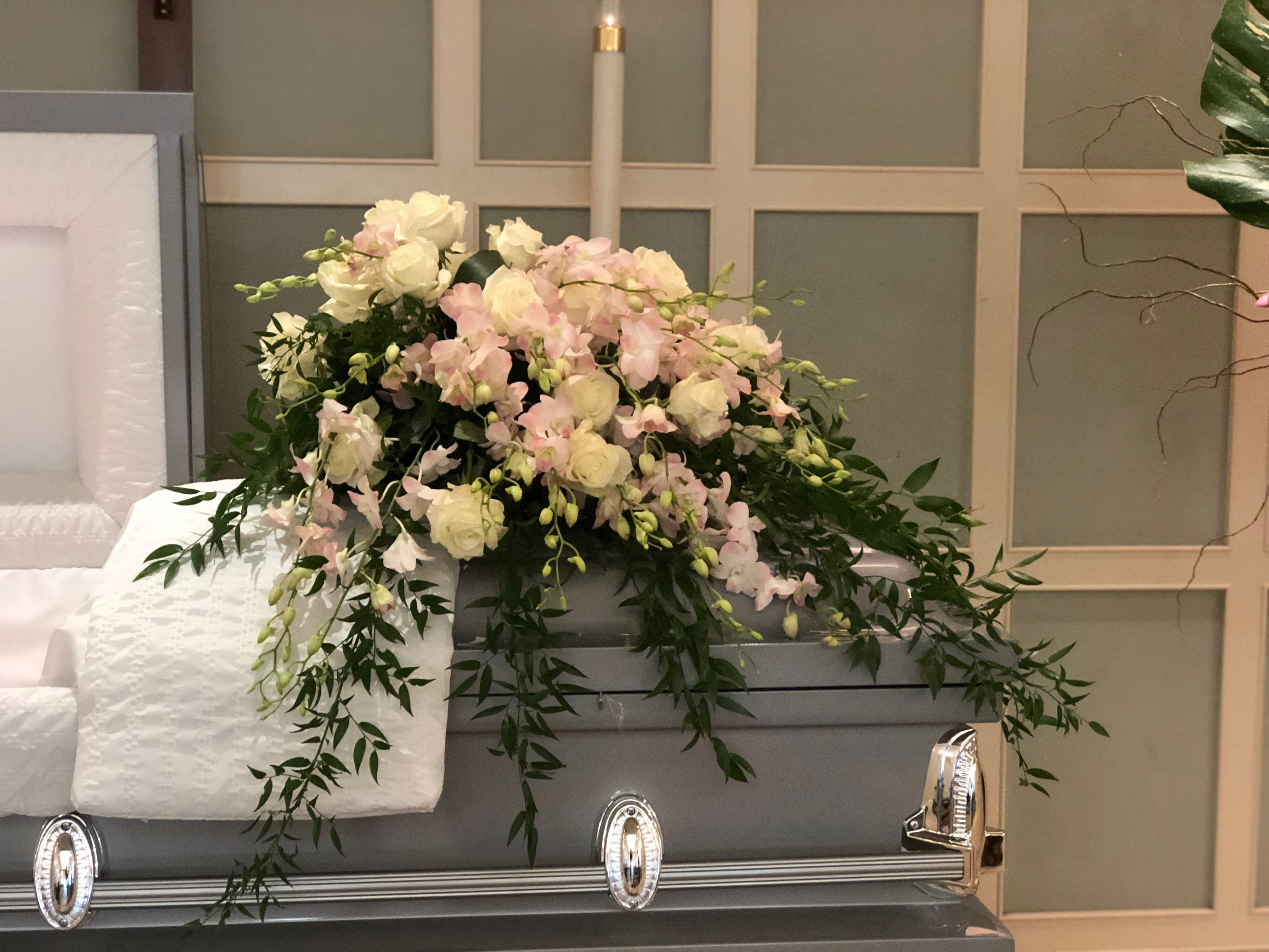 Florals with grace casket spray using white roses pink dendrobium florals with grace casket spray using white roses pink dendrobium orchids italian ruscus izmirmasajfo