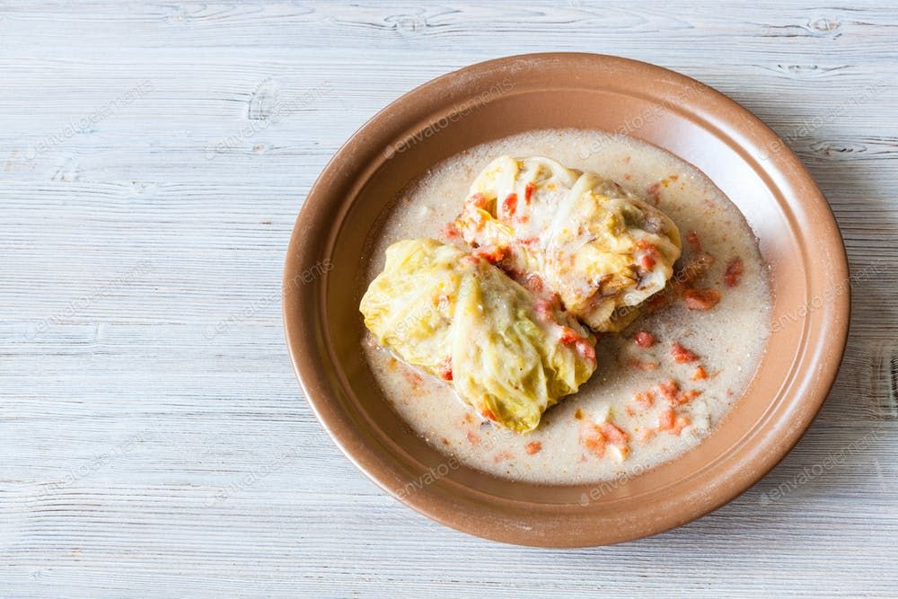 top view of stewed cabbage rolls on gray table By vvoennyys photos