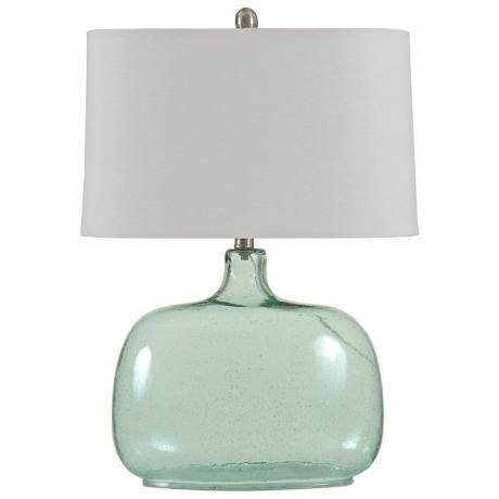 Give your room a contemporary feel with this teal seeded glass table lamp its blue glass jug style base is just the modern touch your space needs