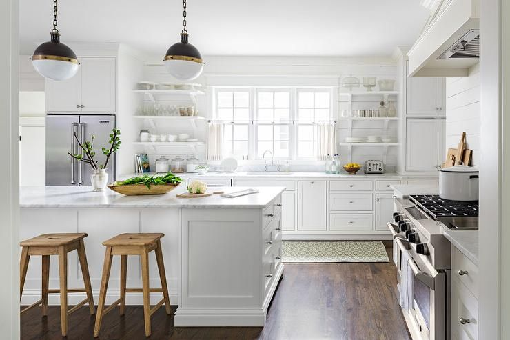 White Country Kitchen Features White Cabinets Paired With White Marble Countertops And A Shiplap Backsp Kitchen Decor Modern Country Kitchen Kitchen Renovation