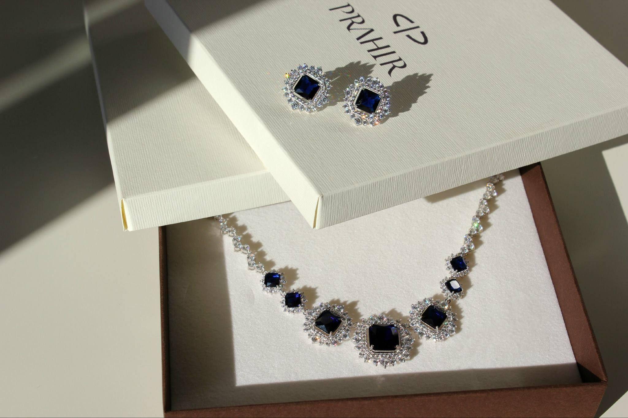 With dark blue stones