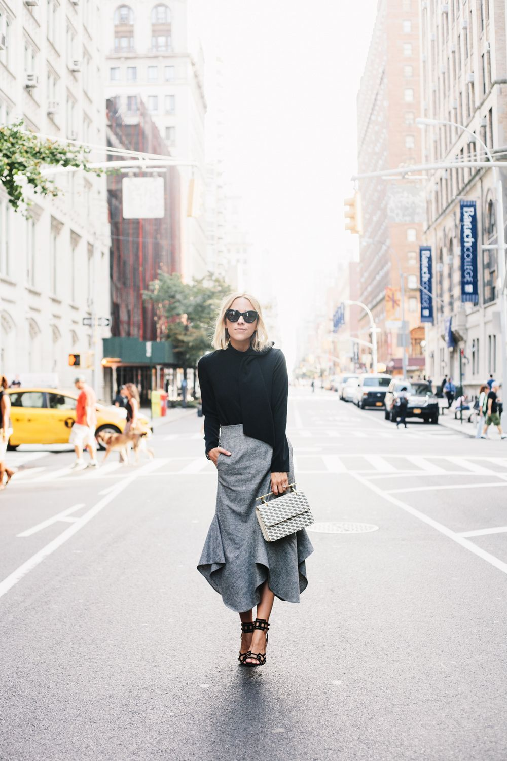Try pairing a black bow top with a statement grey skirt this fall. Via  Jacey Duprie. Bow Top  TY-LR Reniard 99a35054a