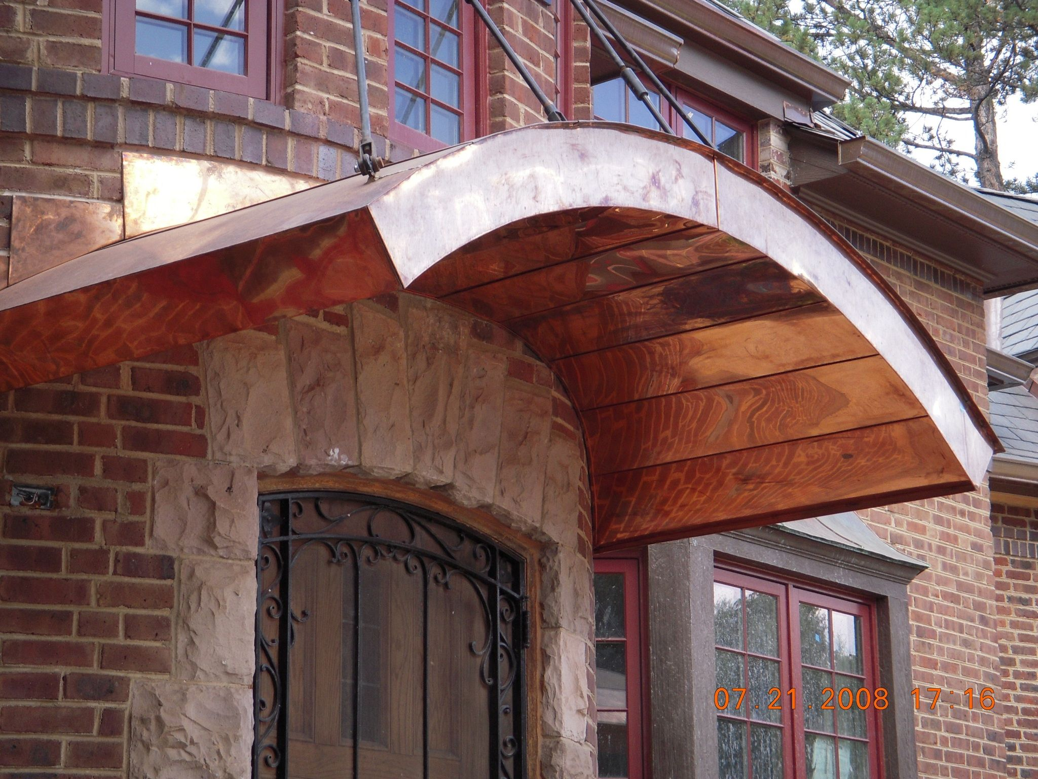 Arched flat seam door awning. Raleighroofing.com (With ...