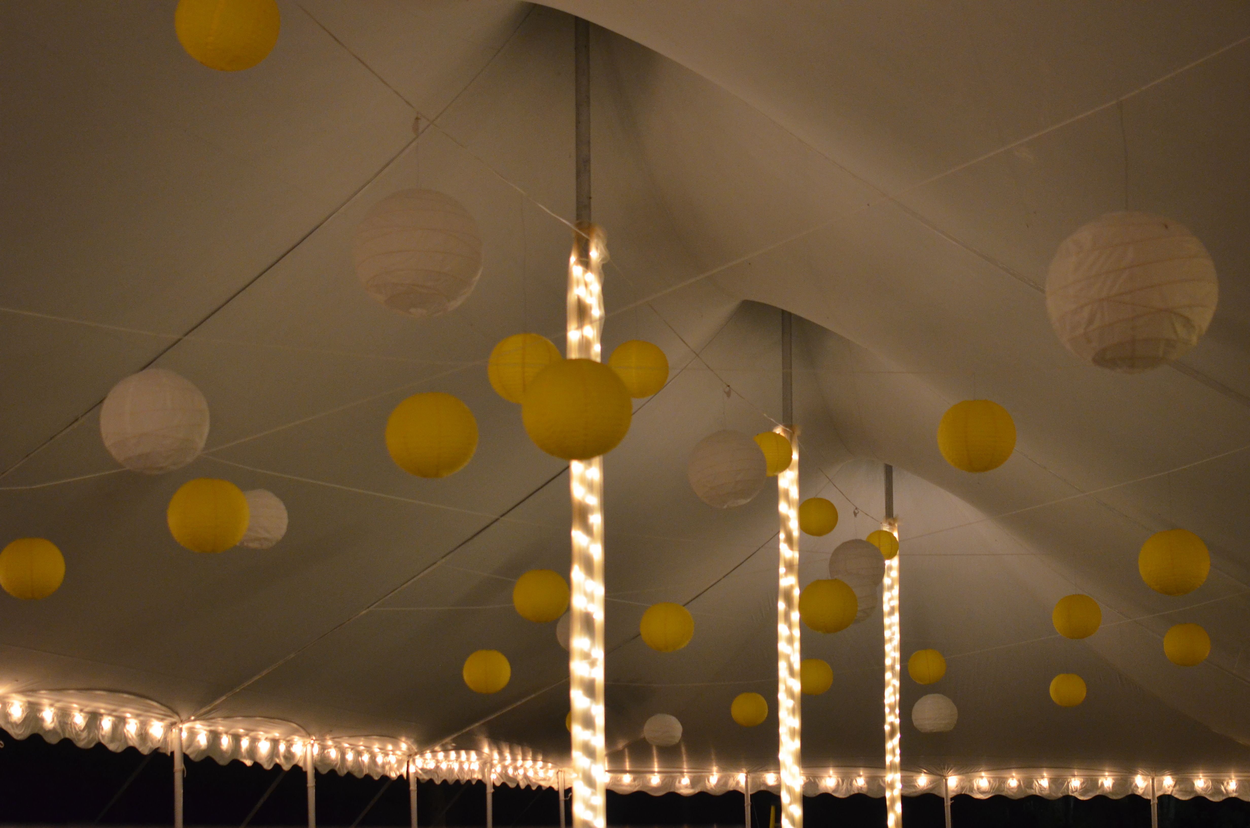 Wedding decorations tulle and lights  The tent was decorated with white and yellow paper lanterns The