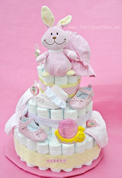Pink and Yellow Modern Diaper Cake by www.fancyparties.es #diapercake #diaper #newborngift