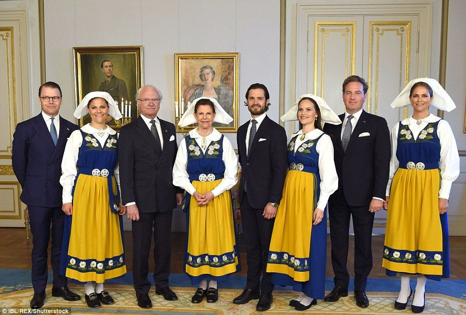 The Swedish royals put on a festive display on Tuesday as they celebrated National Day. Pictured, left to right: Prince Daniel, Crown Princess Victoria, King Carl Gustaf, Queen Silvia, Prince Carl Philip, Princess Sofia of Sweden, Chris O'Neill, and Princess Madeleine