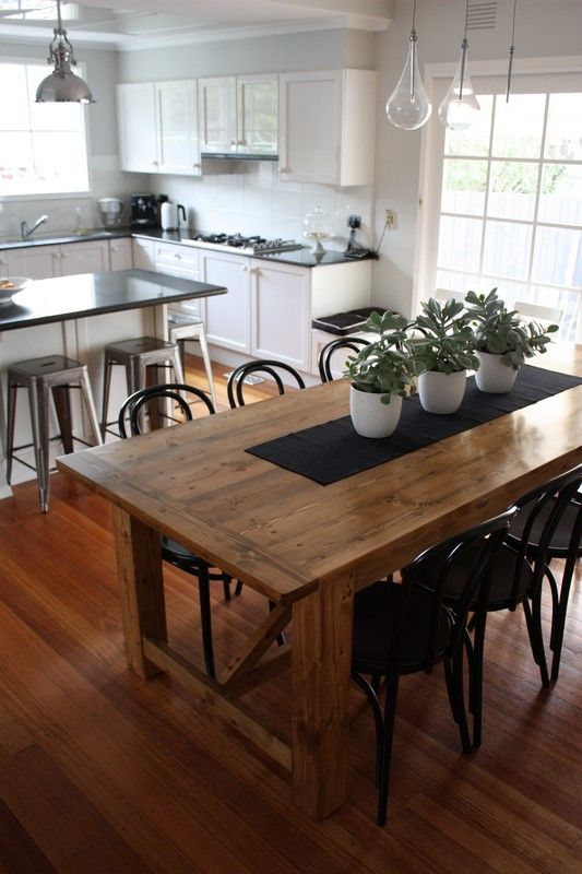 Dining Room Affordable Rustic Tables 6 Black Steel Chairs Have 3 Flowers Pot On The Table Above Laminate Wood Floor Front Kitchen Cabinets