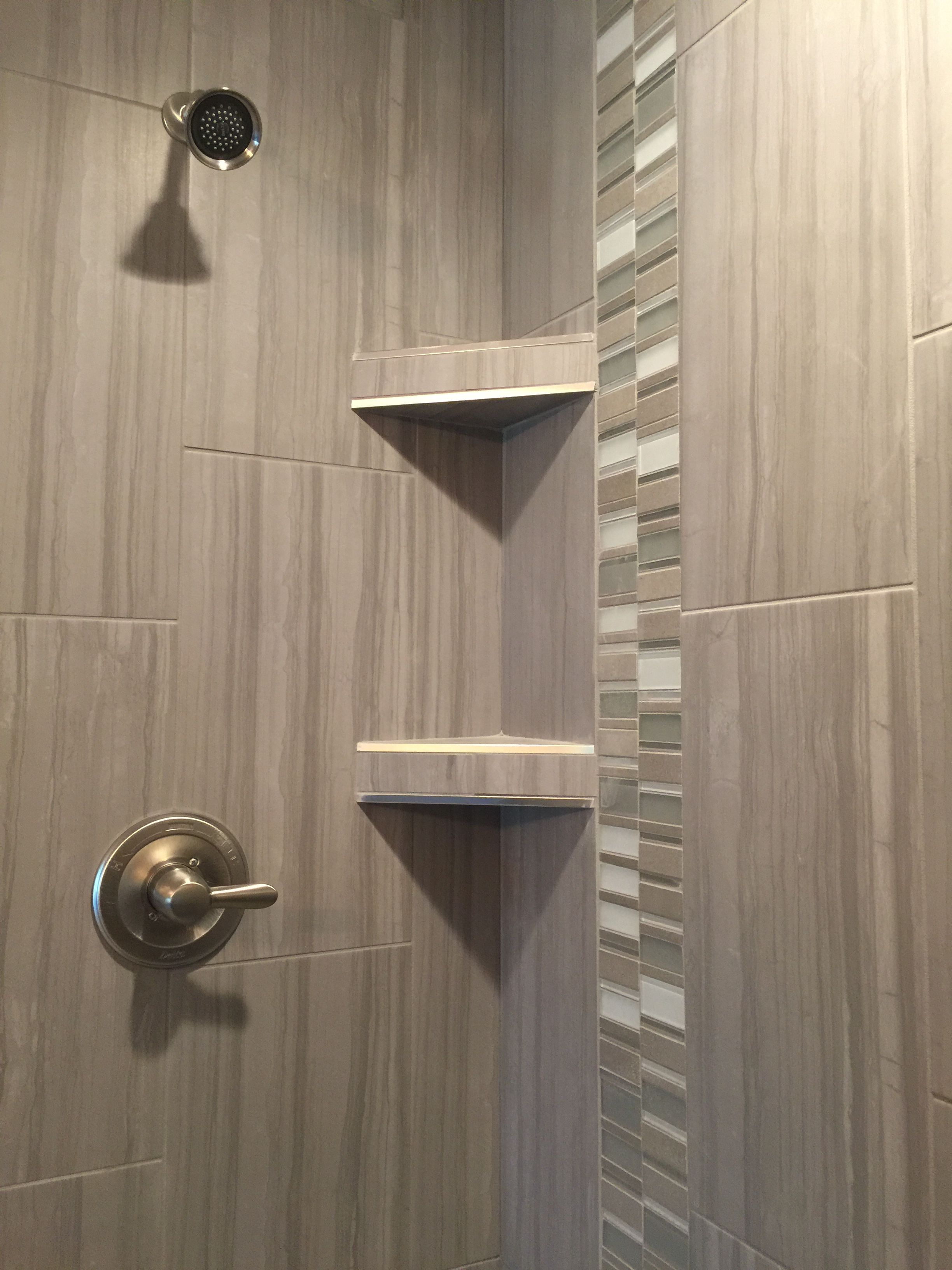 Custom Tiled Shower In A 12x24 Porcelain Tile Install 1 3 Staggered Vertically With A Stone And Glass Mosaic Ac Shower Tile Glass Tile Shower Floor Tile Design