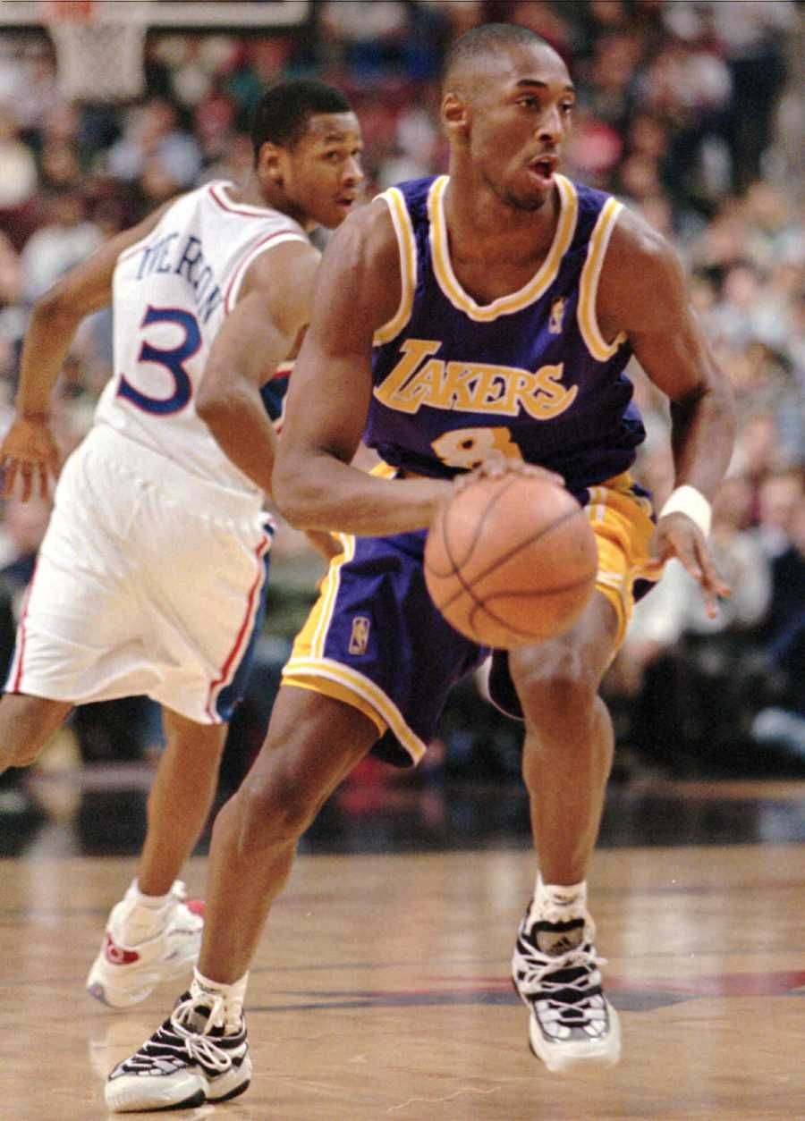 Los Angeles Lakers Kobe Bryant, right, moves past