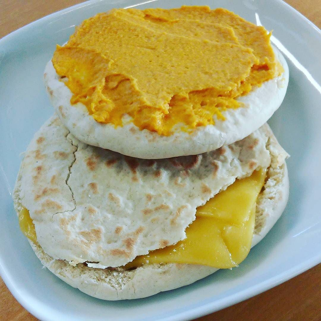 Who wouldn't enjoy a warm breakfast of cheezy pita bread and pita with pumpkin hummus? by thevegantraveler