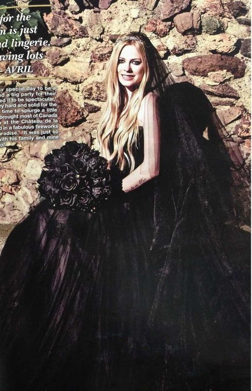 8dcb633d39b25 Canadian singer-songwriter Avril Lavigne wore a black wedding dress to say  her vows to rocker Chad Kroger, frontman of the band Nickelback, on July 1,  2013.