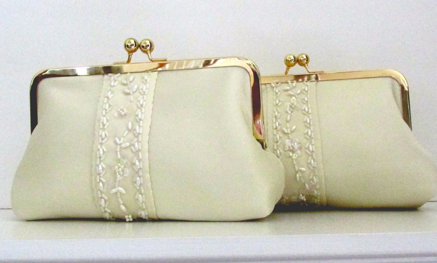 Wedding dress preservation box  Took sleeves from momus wedding dress and made these clutches for my