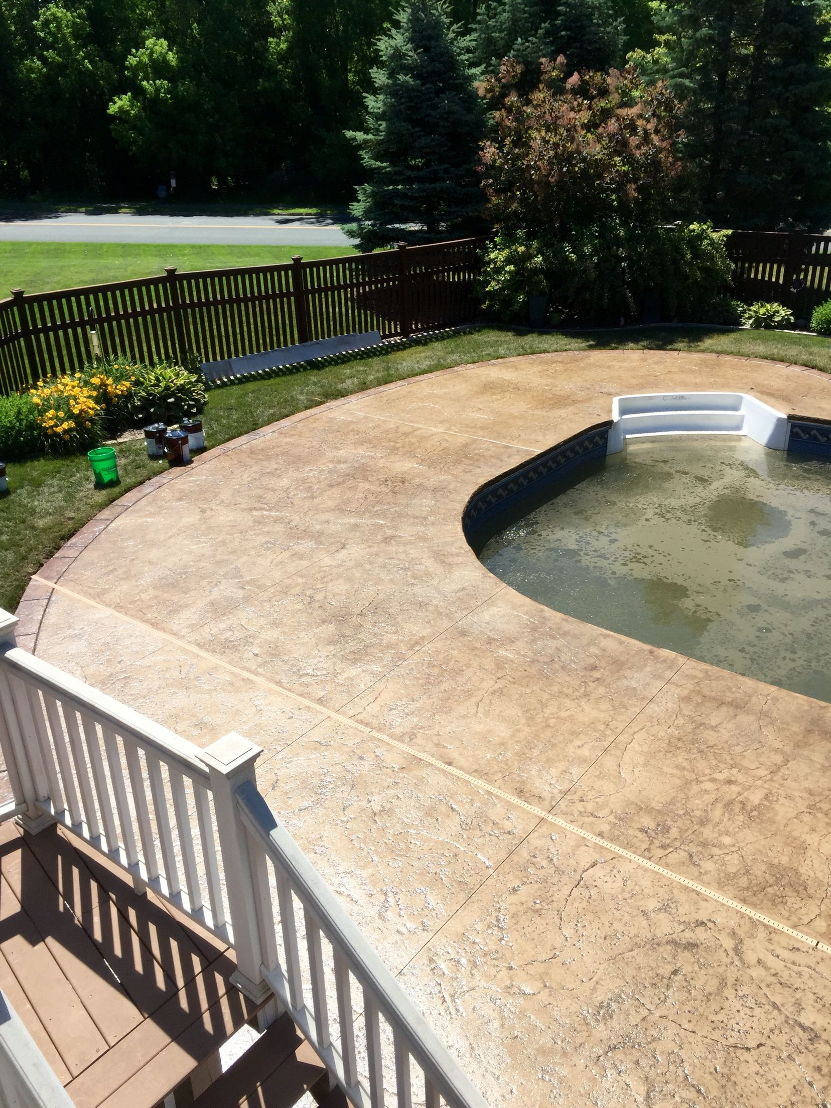 Stamped Concrete Pool Deck With Custom Chiseled Stone Cantilevered Concrete