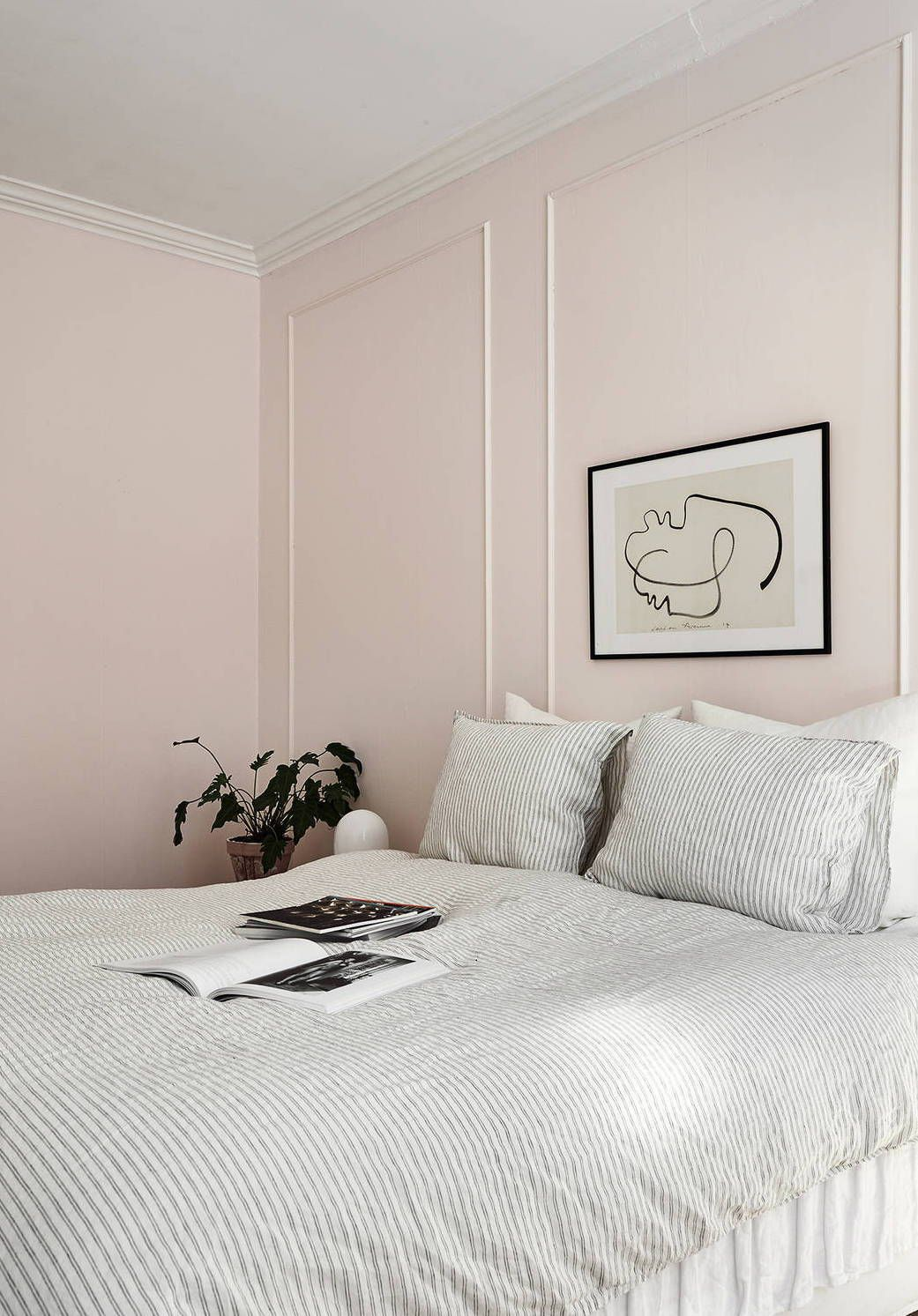 Chic Pink Bedroom Features A Wall Clad In Silver And Pale Pink