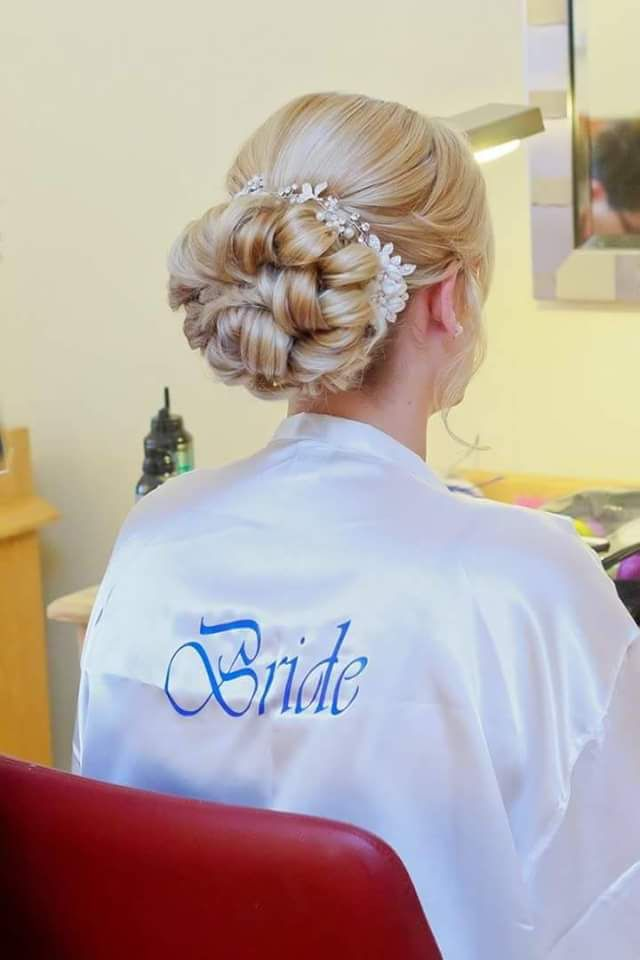 Brides Hair Up Low Curly Bun With Vine Above