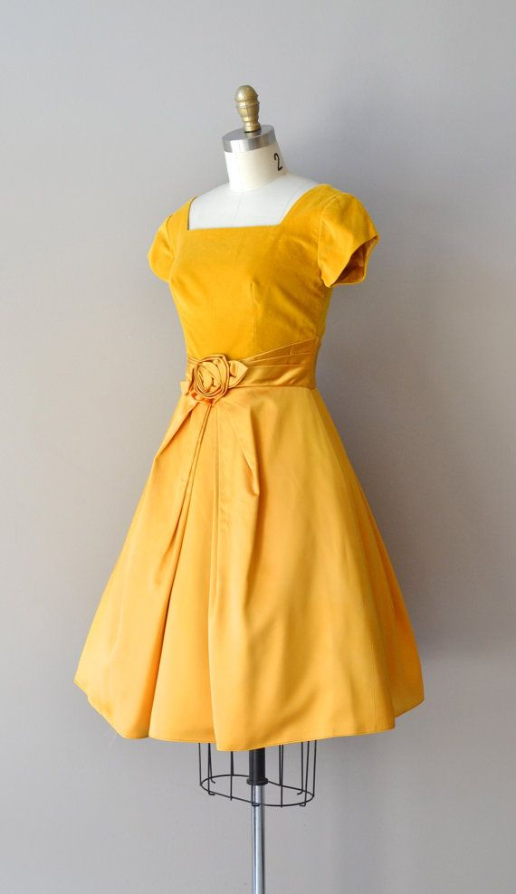 1960s dress. I like the combination of matte and satin, and the belt. Though I don't think yellow looks good on me.