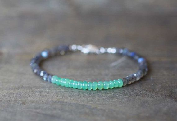 This gemstone bracelet is made up of faceted labradorite and smooth, plump chrysoprase beads. The chrysoprase beads are the tiniest bit translucent, which makes the color a kind of bright pastel green. It is such an interesting shade, and pairs beautifully with the labradorite. Finished with a lobster clasp in your choice of sterling silver or gold filled.  Gemstones measure approx 4-4.5mm. Bracelet measures 7 inches total.